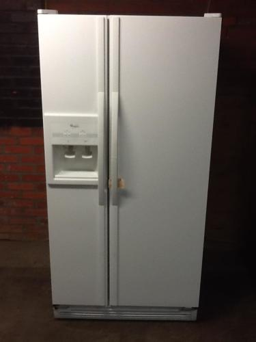 Whirlpool side by side refrigerator with ice and water dispenser