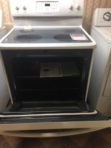 Frigidaire self clean electric range timer storage drawer & window.